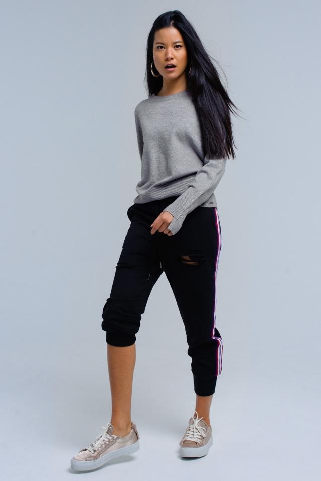 Pantalon noir avec des déchirures