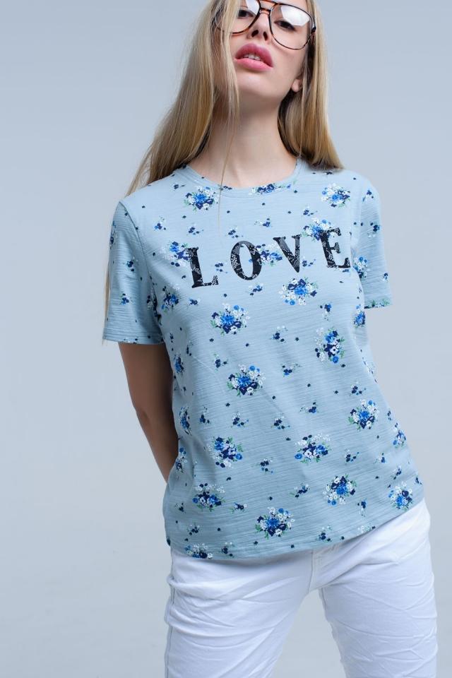 T-shirt bleu avec imprimé floral et logo