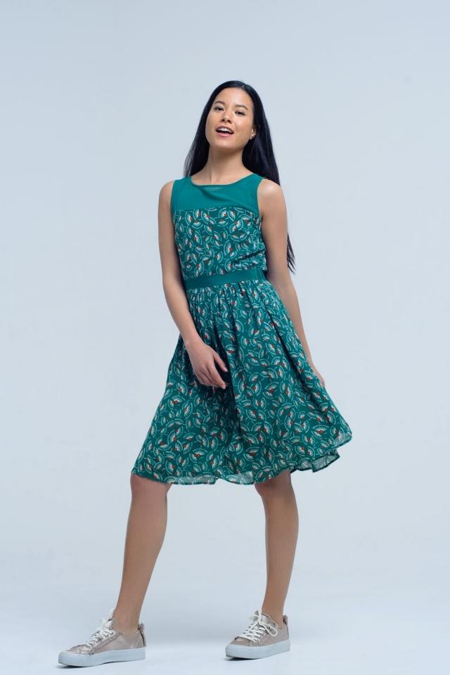 Mini robe verte avec imprimé géométrique et noeud