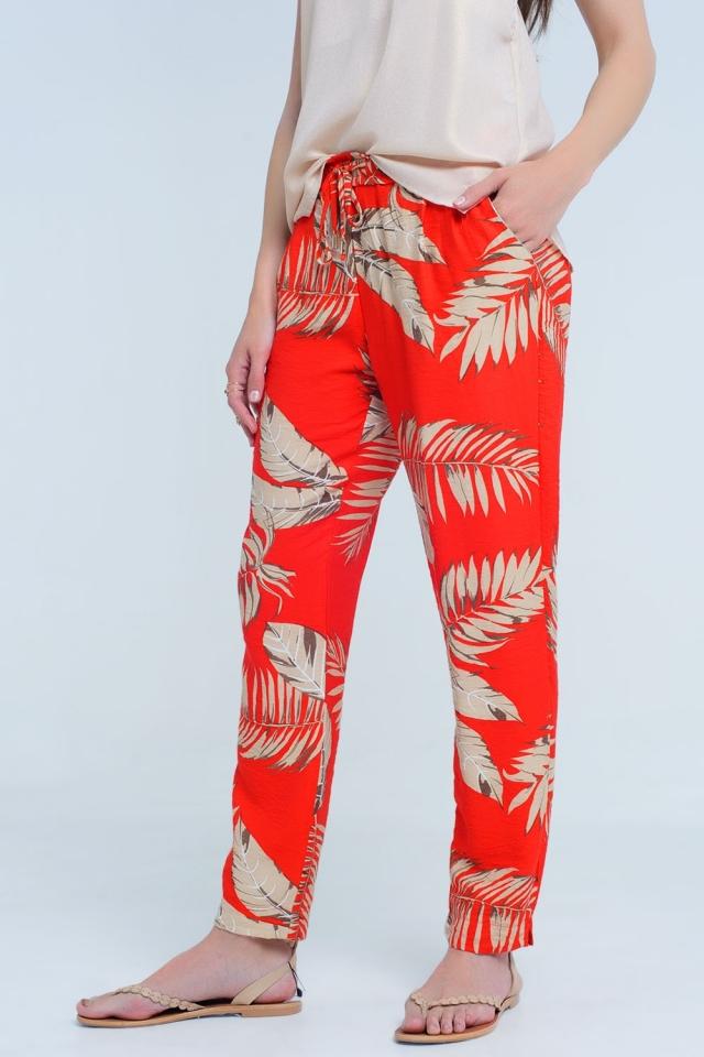 Pantalon rouge avec impression de feuille