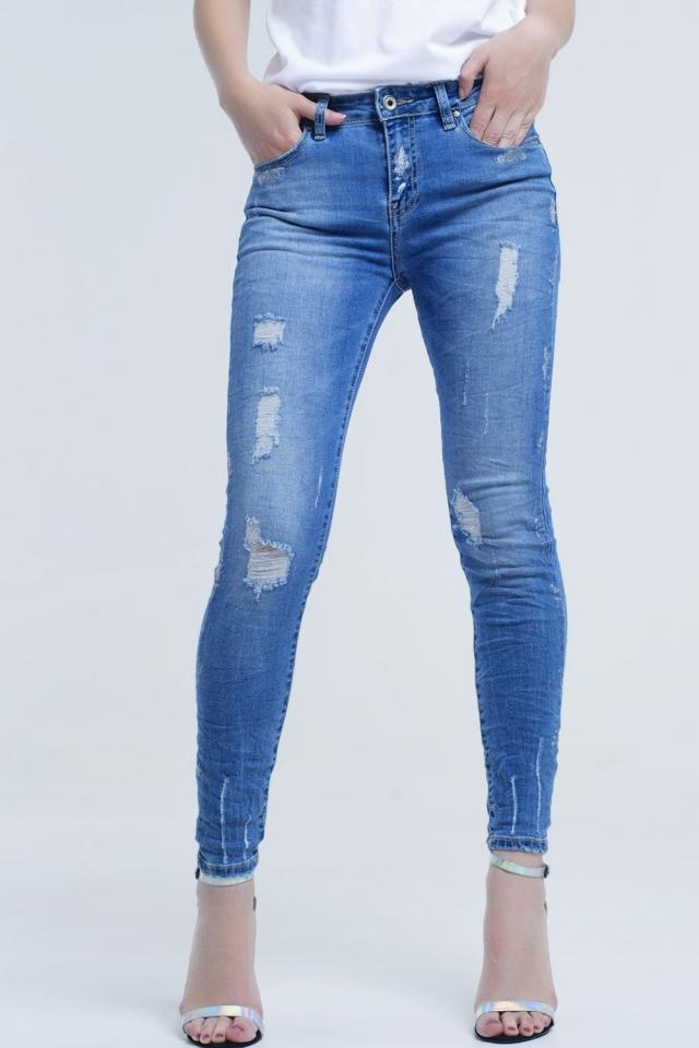 Jean skinny avec déchirures et paillettes