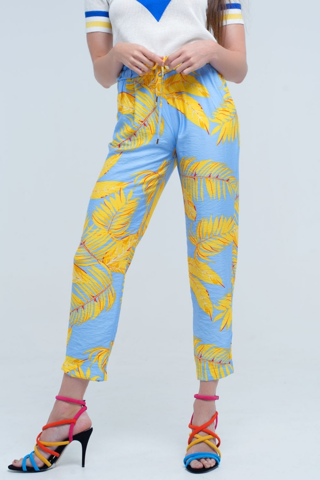 Pantalon jaune avec imprimé feuilles et poches