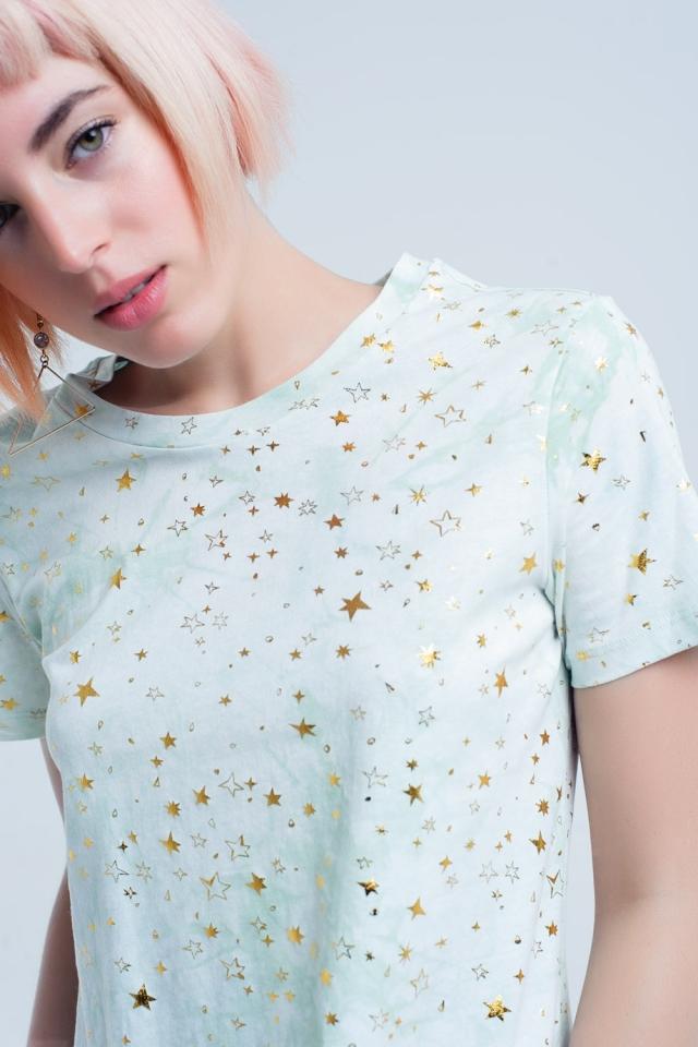 Effet délavé de t-shirt vert avec des étoiles dorées