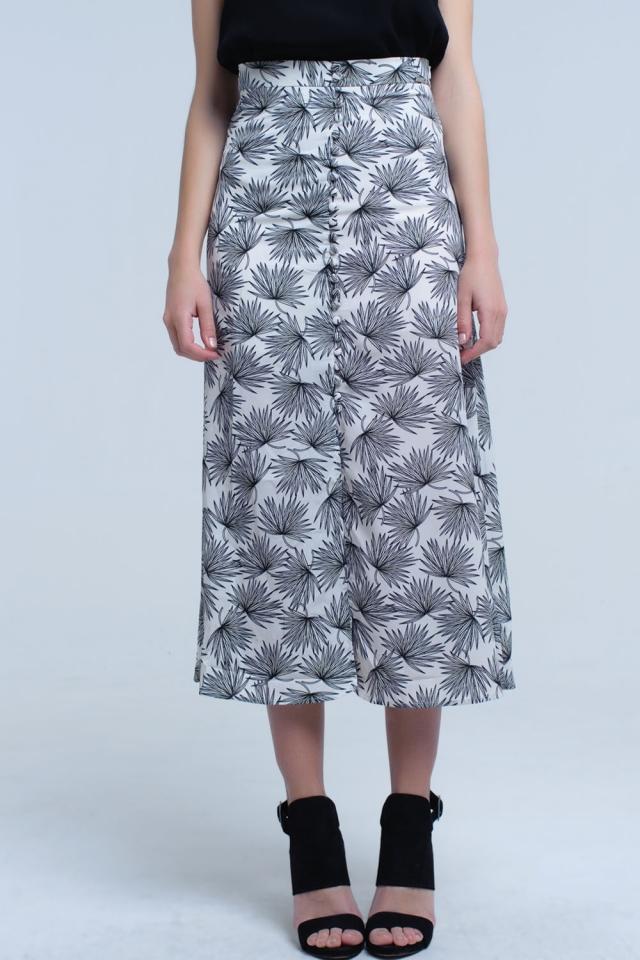 Jupe mi-longue blanche avec détail boutonné et imprimé feuille