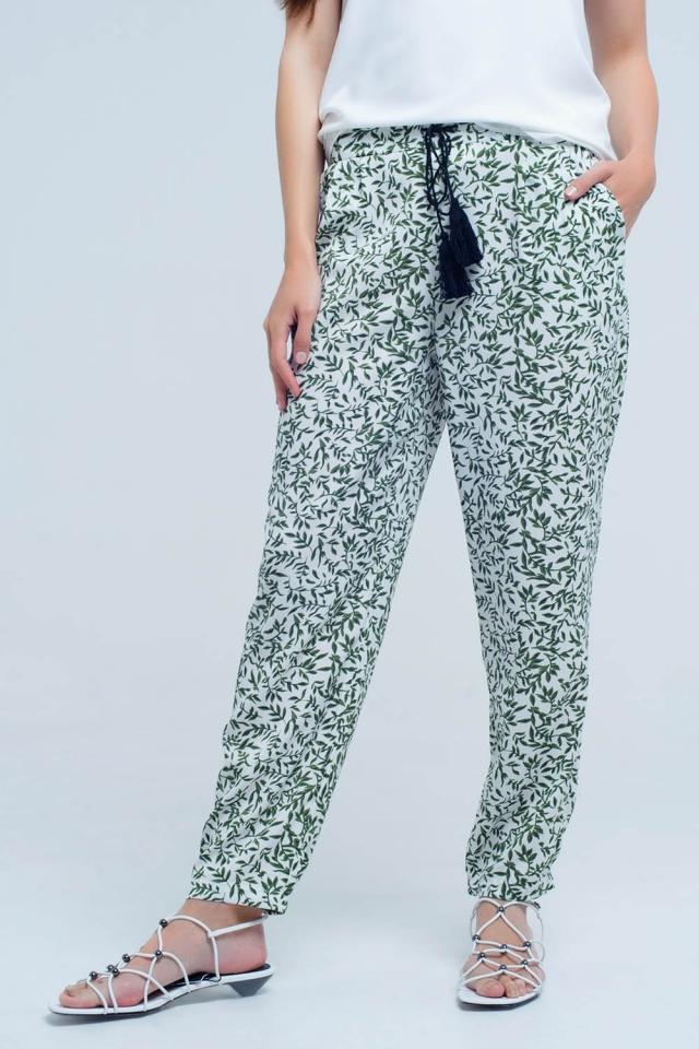 Pantalon vert avec des feuilles imprimées et des poches