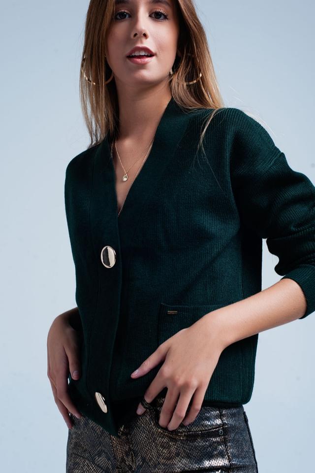 Cardigan vert foncé avec boutons dorés