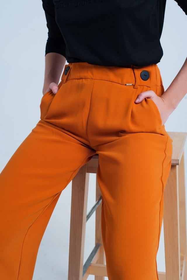 Pantalon large orange avec boutons