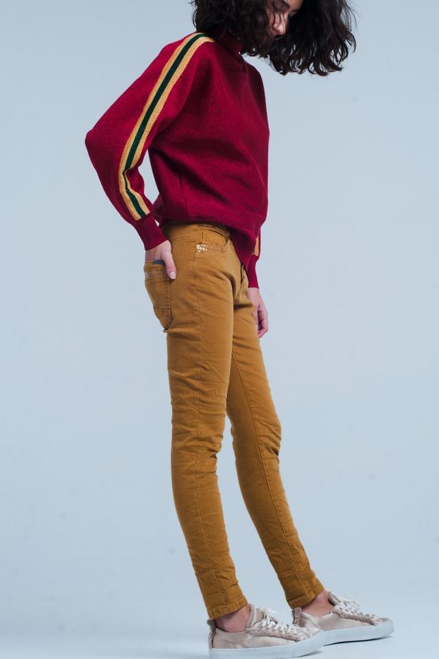 Pantalon moutarde avec boutons et paillettes