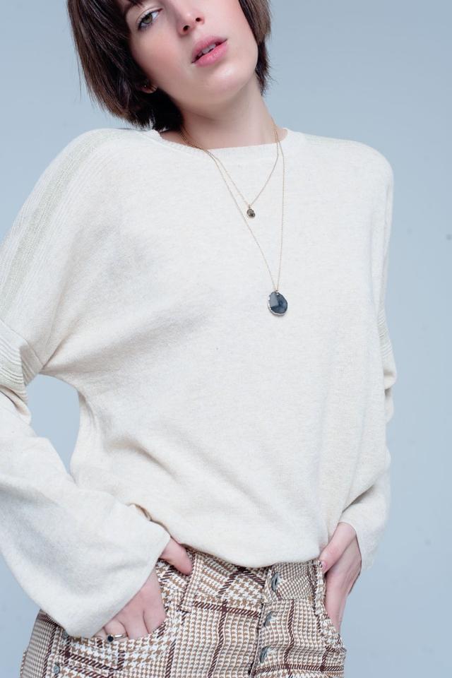 Pull fin tricoté beige avec détails du scintillement