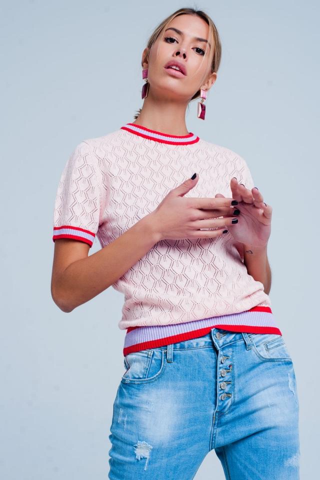 Pull en maille ajourée rosa à motif géométrique