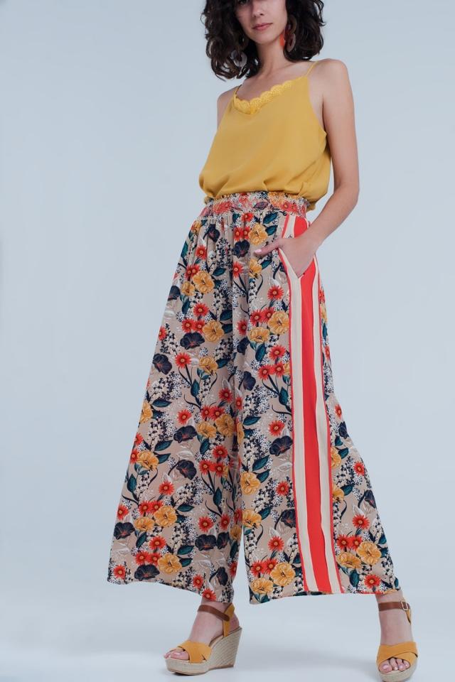 Pantalon beige à fleur avec bande sur le coté