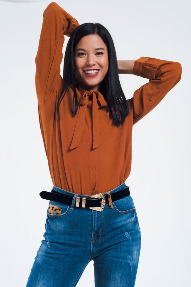 Chemise boutonnée avec détail en dentelle en orange