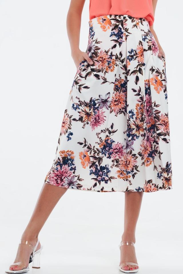 Jupe mi-longue à fleurs avec plis plats crème