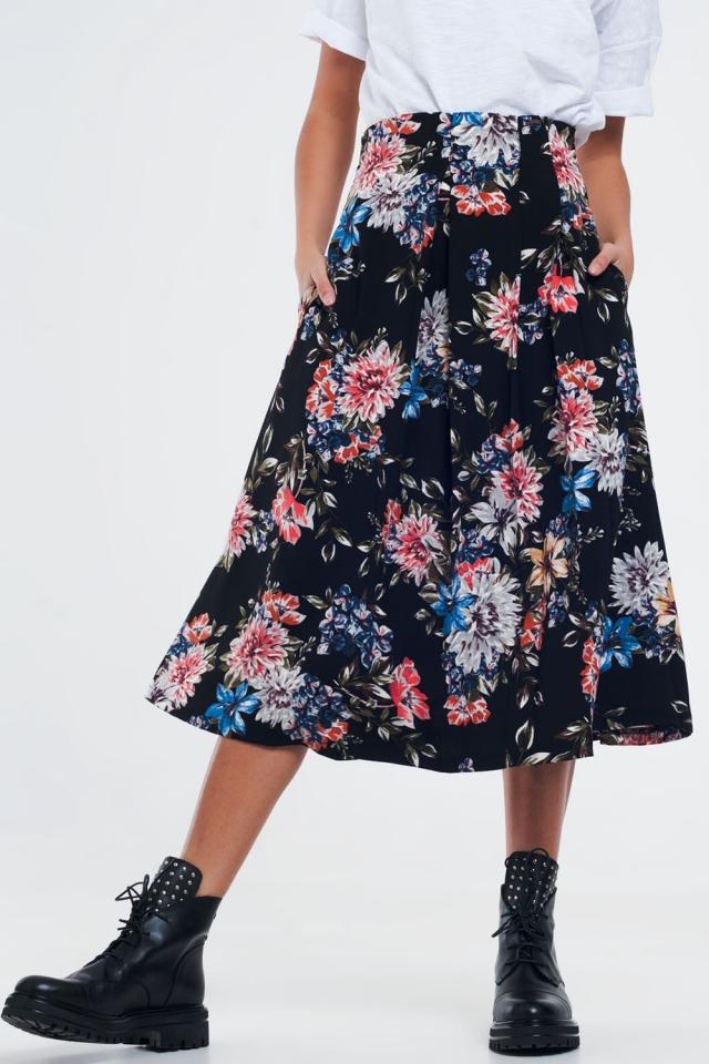 Jupe noire mi-longue à fleurs plissée