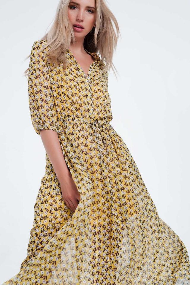 Robe longue jaune à manches longues et fleurs