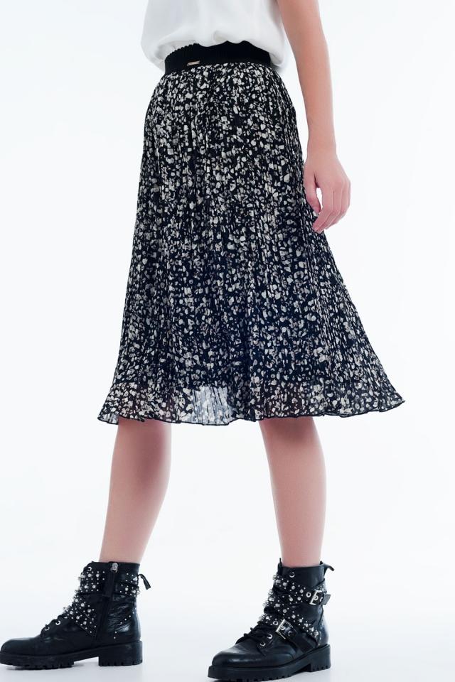 Jupe mi-longue plissée à noir imprimé