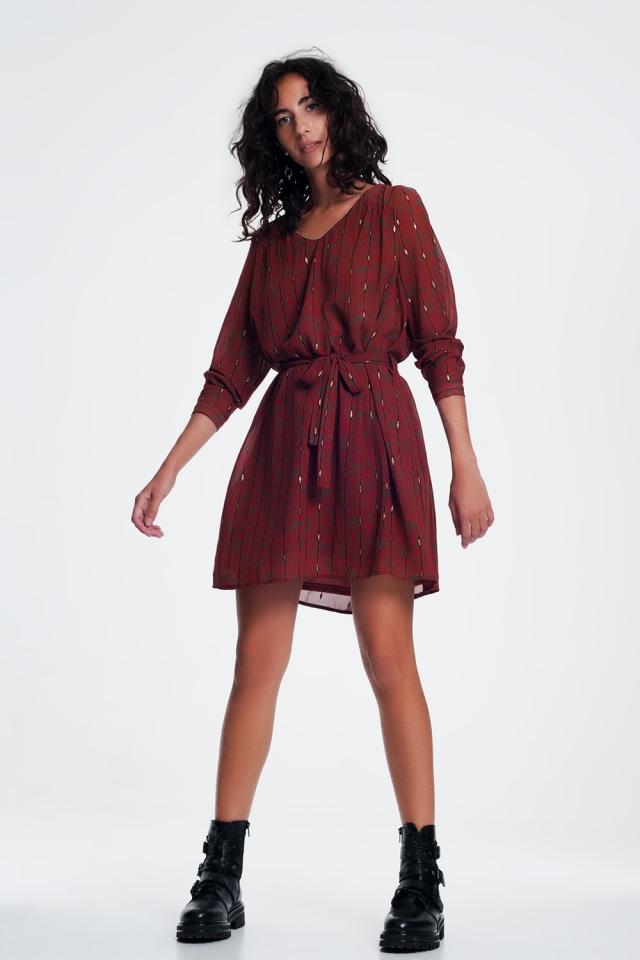 Robe avec une taille ceinturée en vintage imprimer en orange