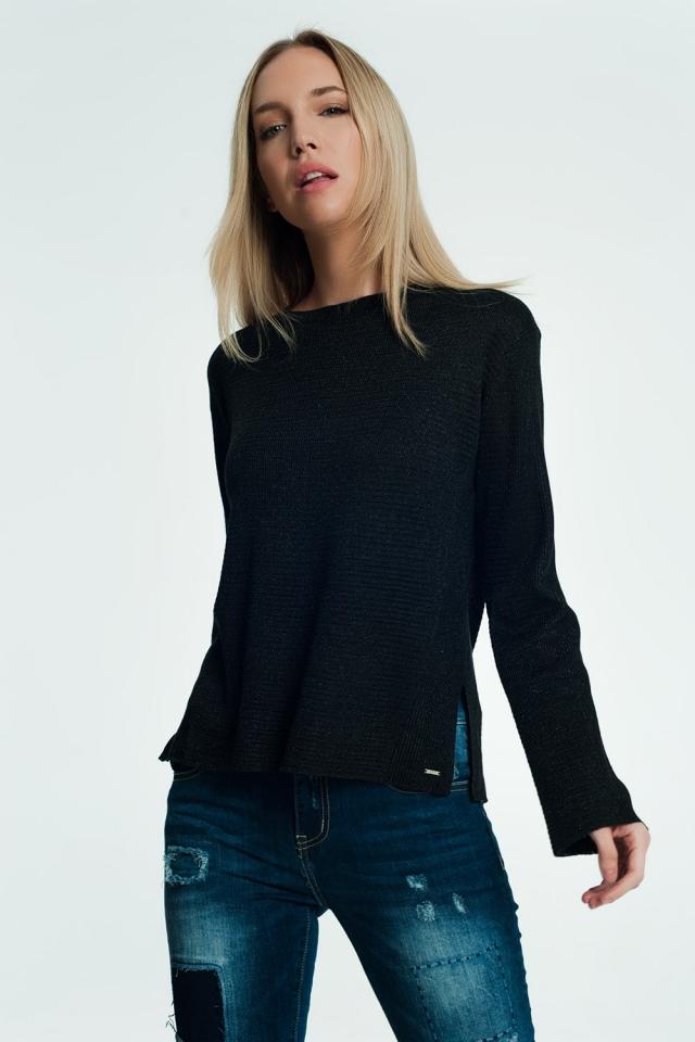 Pull noir avec détails côtelés et tricotés