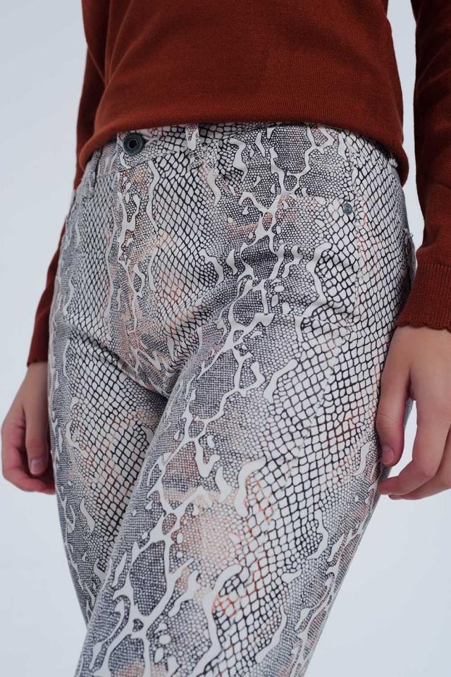 Pantalon texturé à imprimé serpent beige