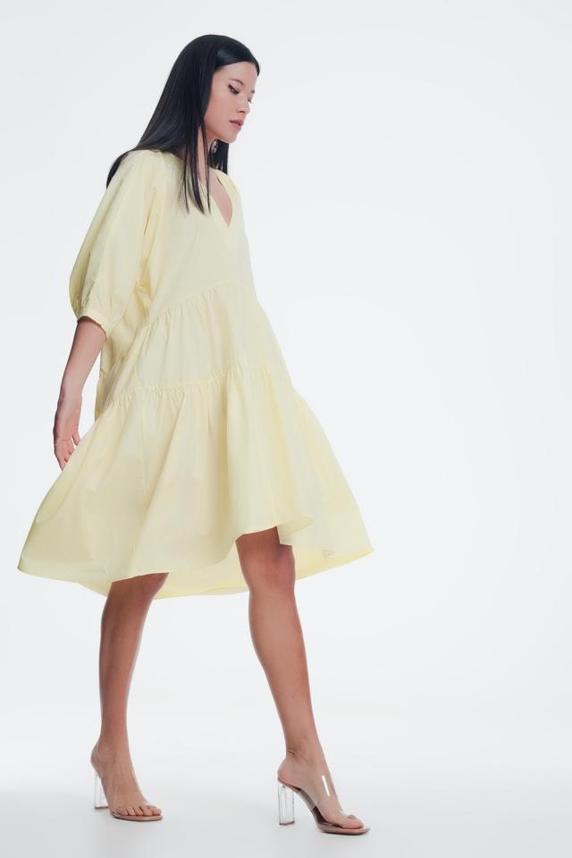 Robe babydoll longueur mollets avec jupe volantée et manches bouffantes jaunes