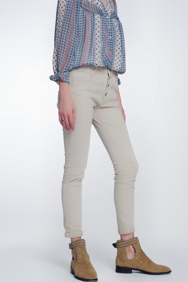 Pantalon boyfriend beige avec le détail de poche de sequin