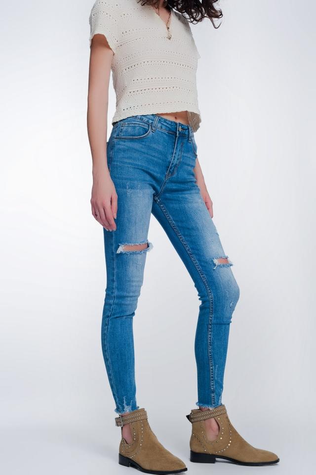 jeans super skinny avec des trous dans les genoux