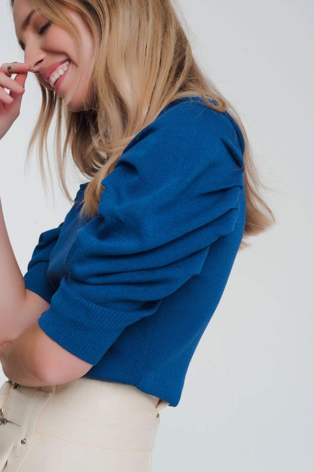 Pull en maille bleu à manches bouffantes