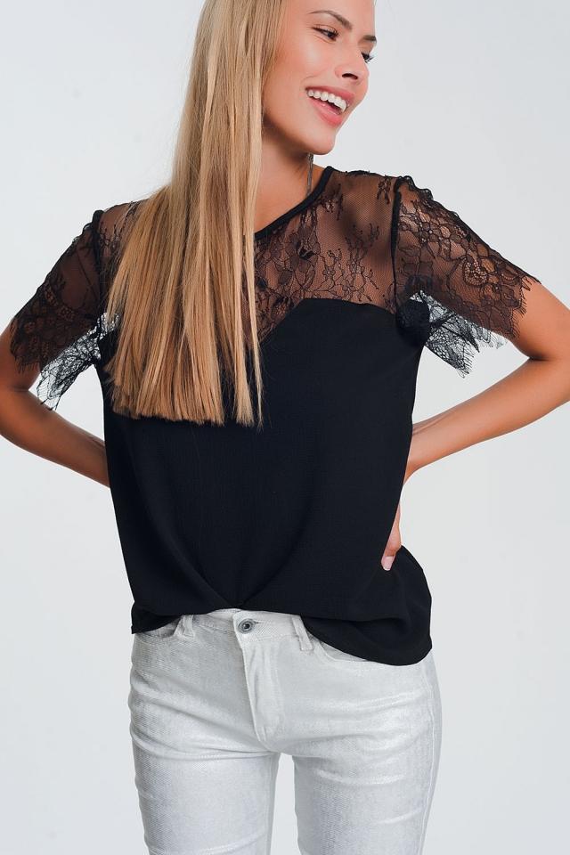 Chemise noire à fleurs en dentelle