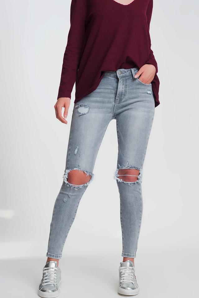 Jean skinny à genoux déchirés gris
