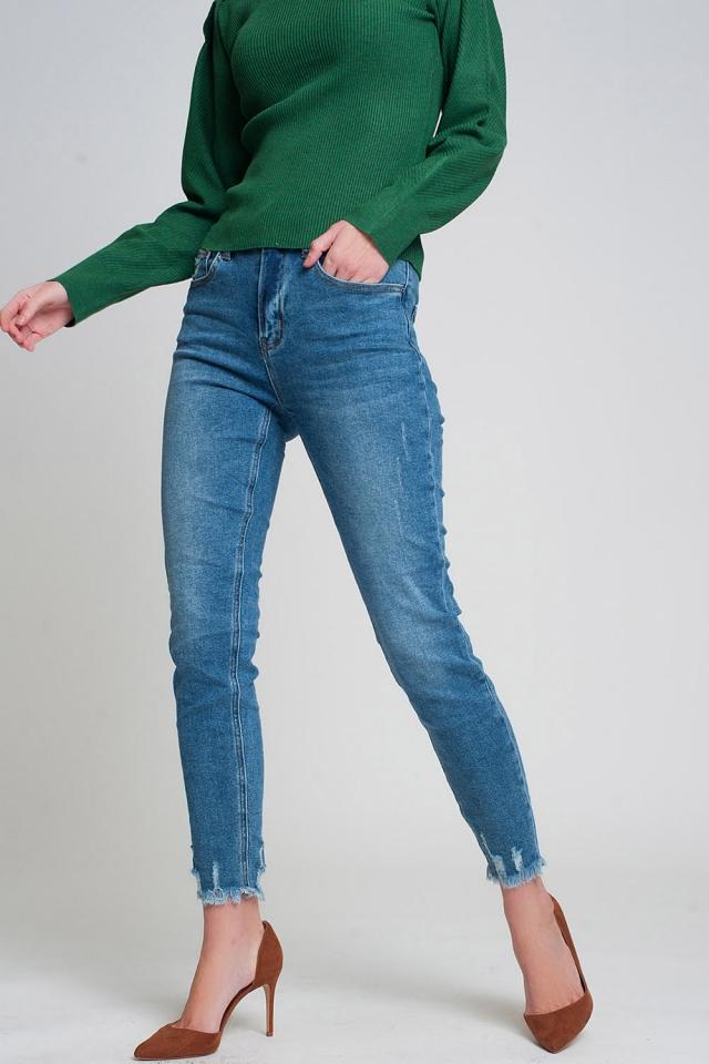 Jeans skinny blu lavaggio scuro con fondo grezzo