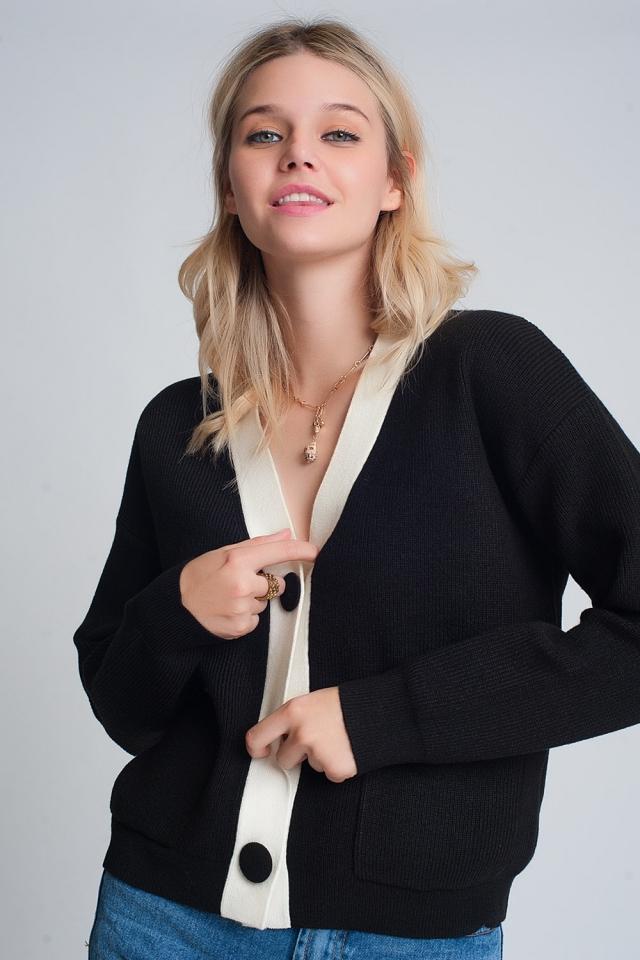 Cardigan en tricot avec détails blancs en noir