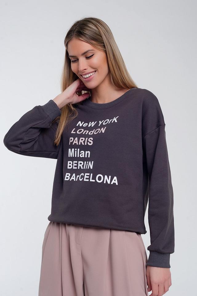 Sweat-shirt avec inscription imprimée sur le devant