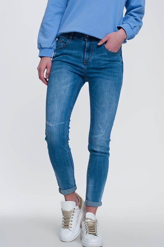 jean skinny en denim léger avec chevilles pliées et détail déchiré