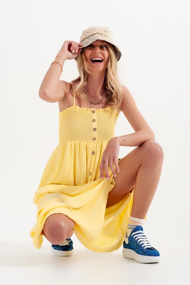 Vestido largo en jaune con pecho fruncido y bolsillos
