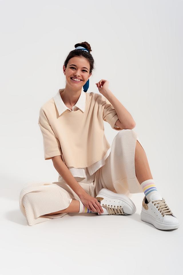 Pantalon plissé style jupe culotte crème